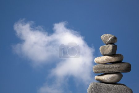 Photo for Pile of stones and cloud - Royalty Free Image