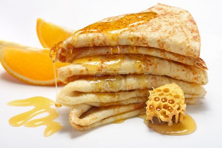 Photo for Two Pancakes wiht honey on white background - Royalty Free Image