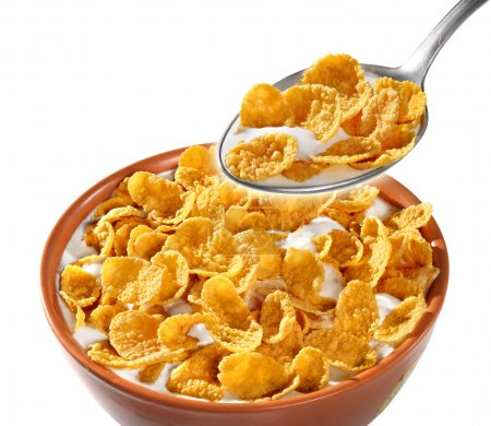 Photo for Bowl with dry corn flakes on the white background - Royalty Free Image