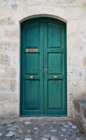 Wooden green door.