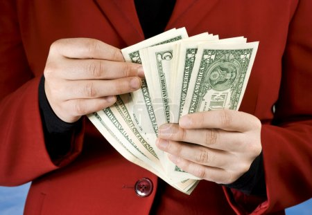 Female hands counting dollar banknotes