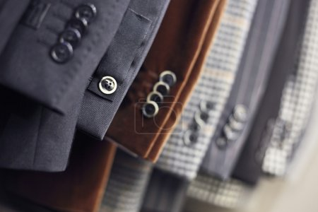 Photo for Detail of men's jackets' line in a shop, DOF - Royalty Free Image