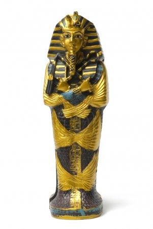 Photo pour Statue de Pharaon dorées et petits jouets reste sur fond blanc - image libre de droit