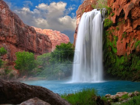 Photo for A beautiful waterfall photographed with a slow shutter speed to blur the water - Royalty Free Image