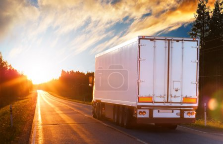 Photo for Truck on the asphalt road in the evening - Royalty Free Image