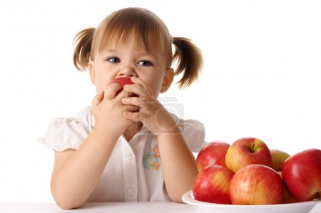 Photo for Cute child eats red apple, isolated over white - Royalty Free Image