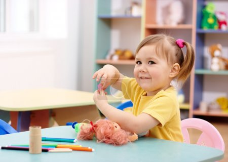 Photo for Cheerful little girl play in preschool, shallow DOF - Royalty Free Image