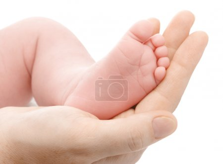 Mother holding her newborn's foot