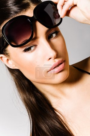 Photo for Beautiful brunette with sunglasses portrait - Royalty Free Image