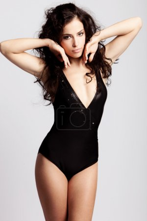 Photo for Brunette woman in swimsuit studio shot - Royalty Free Image