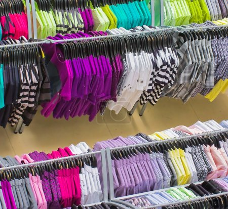 Photo for Rows of colorful clothes on hangers in shopping mall - Royalty Free Image