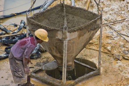 Construction worker assisting pourer (2)