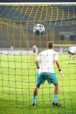 Goalkeeper and ball
