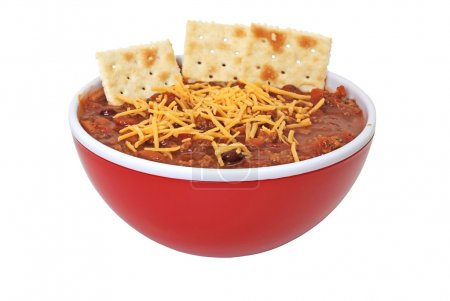 Photo for Bowl of chili with shredded cheese and crackers isolated on white background. - Royalty Free Image
