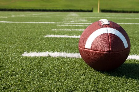 Photo for Closeup of American football on field with yard lines. - Royalty Free Image