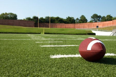 Closeup of American Football on Field