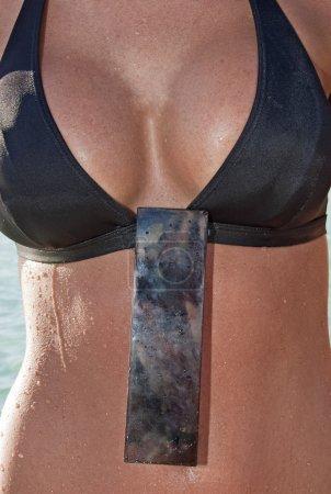 Body of a woman in a bikini top
