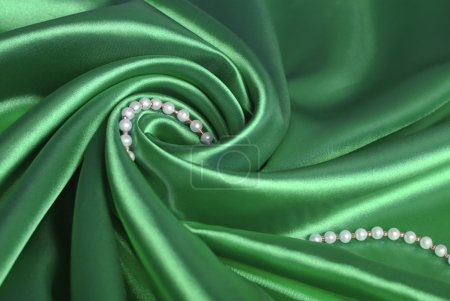 Pearl beads on green silk