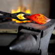 Incandescent element in the smithy on the anvil...