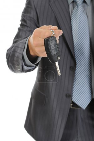 Businessman gives the keys to the car