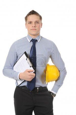 Photo pour Homme d'affaires avec casque jaune de construction. Isolé sur blanc - image libre de droit