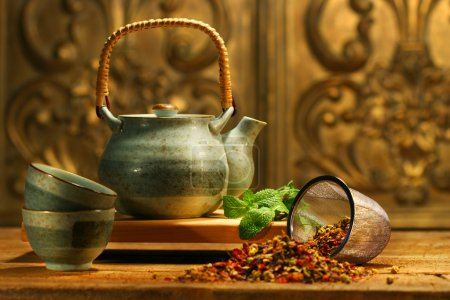 Photo for Asian herb tea on an old rustic table - Royalty Free Image