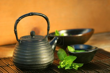 Photo for Japanese teapot and cup with mint tea - Royalty Free Image