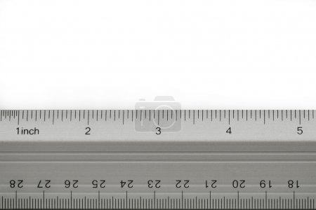 School metal ruler on white background...