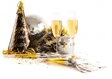 Champagne glasses with festive party hats on white