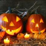 Scarved jack-o-lanterns lit for halloween...