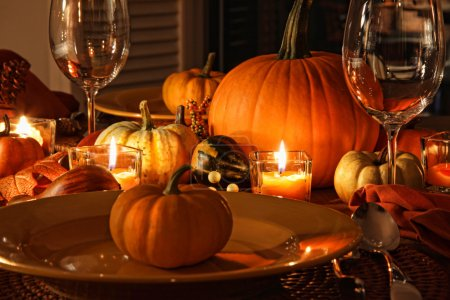 Photo for Festive autumn place settings with pumpkins and candles - Royalty Free Image