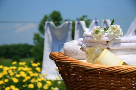 Photo for Clean towels freshly folded in wicker basket - Royalty Free Image