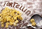 Fresh, raw tortellini with flour