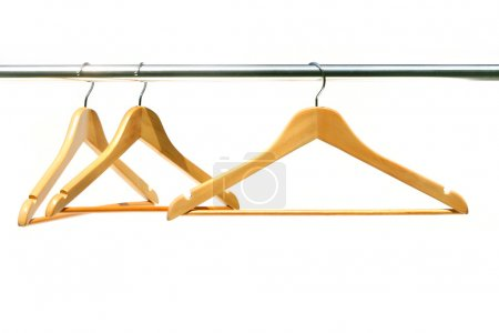 Photo for Three coathangers on a clothes rail - Royalty Free Image