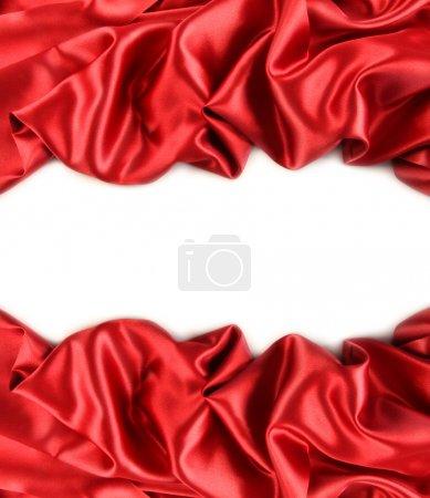 Photo pour Tissu satin rouge sur fond blanc - image libre de droit