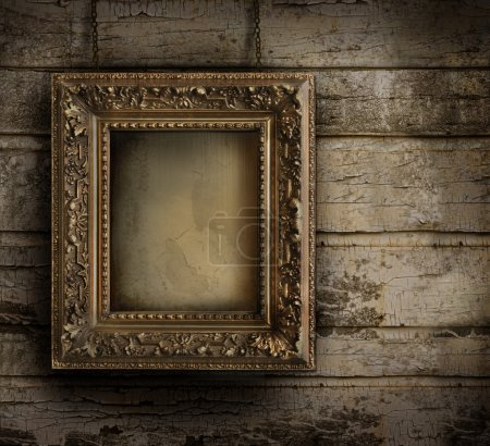 Photo for Old frame against a grungy, peeling painted wall - Royalty Free Image