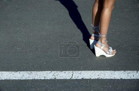 Sexy slim legs of the streetwalker