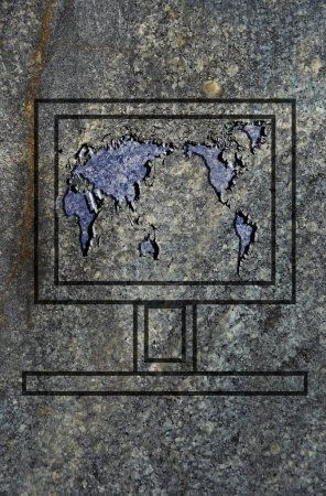 Laptop screen with world map on the granit surface