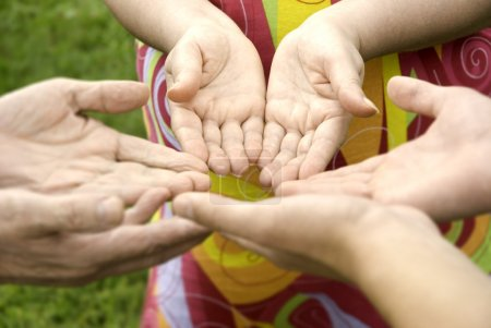 Photo pour Hands of the family (focus on hands of woman(selective)) - image libre de droit