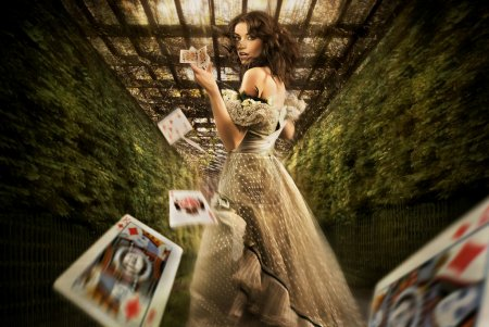 Photo for Vintage female magician throwing playing cards - Royalty Free Image