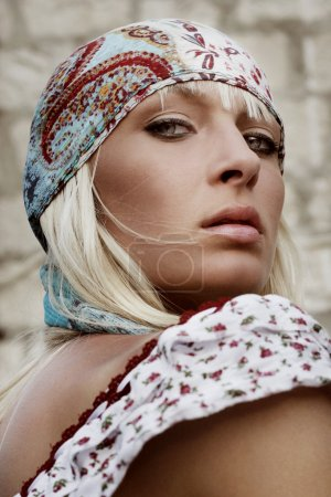Portrait of a young attractive blond beauty, hippie look