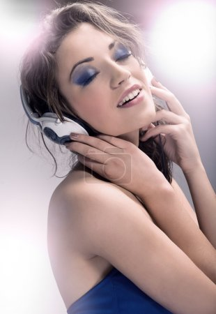 Young beauty listening to the music