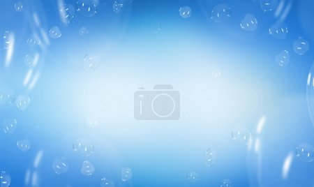 Heart shaped soap bubbles over blue background