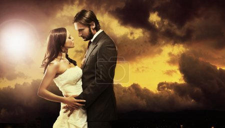Fine art photo of an attractive wedding couple