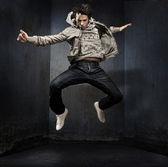 Young hip-hop dancer over a grunge wall