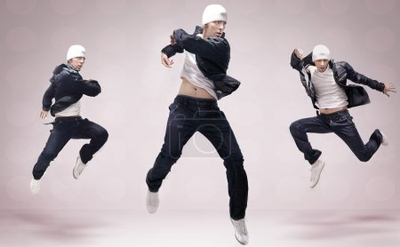 Abstract studio photo of three hip hop dancers