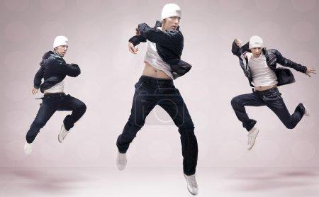Abstract studio photo of three hip hop dancers