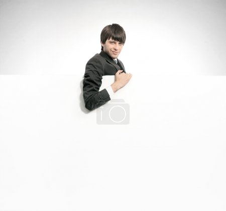 Photo for Young manager holding a empty white board - Royalty Free Image