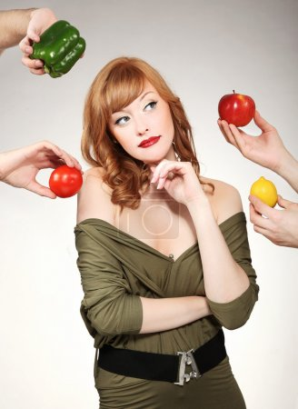 Beautiful woman making a vegetable choice