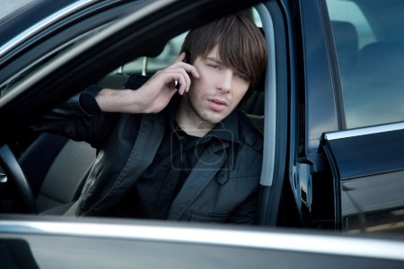 Elegant man in a car, calling
